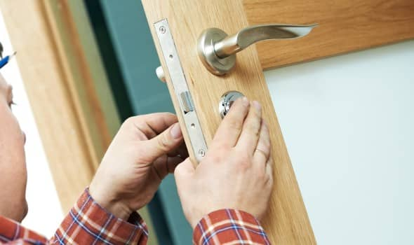 Locksmith replacing a lock